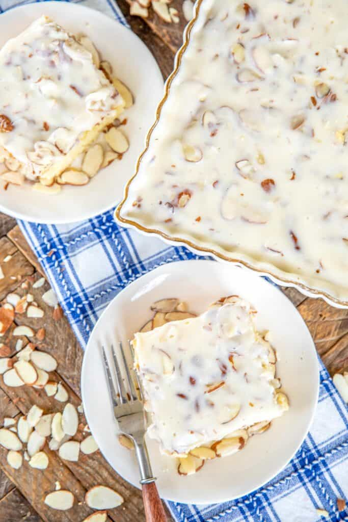 slice of white cake topped with almonds and icing