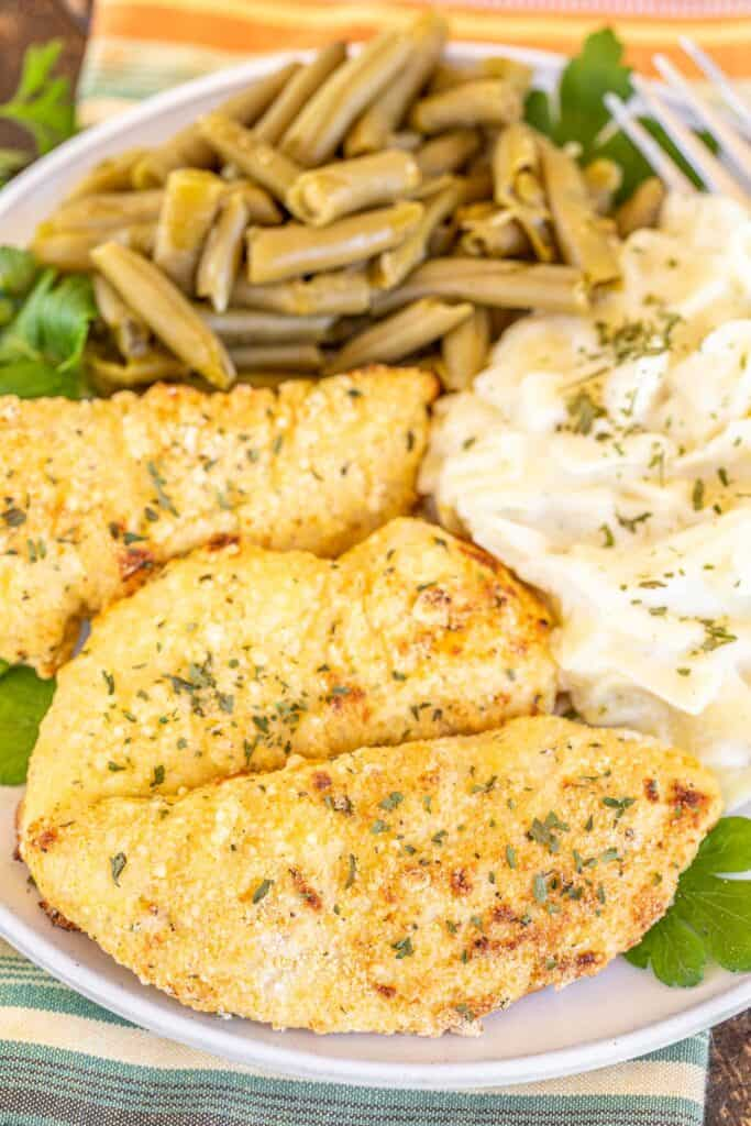 plate of chicken tenders with pasta and green beans