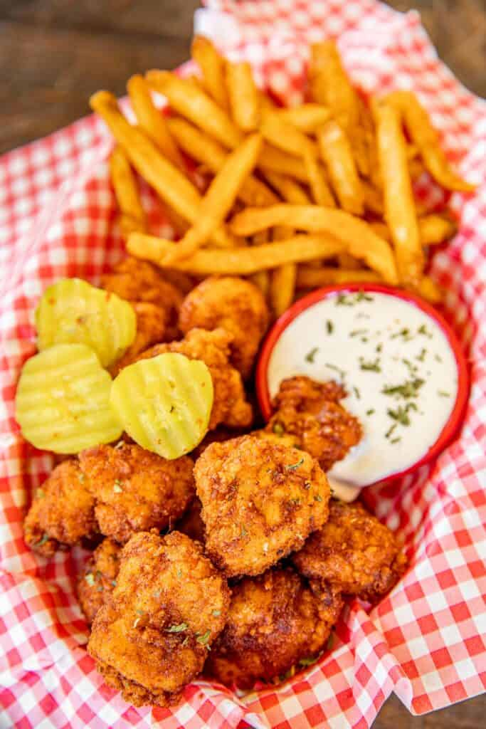 basket of hot chicken nuggets and fries