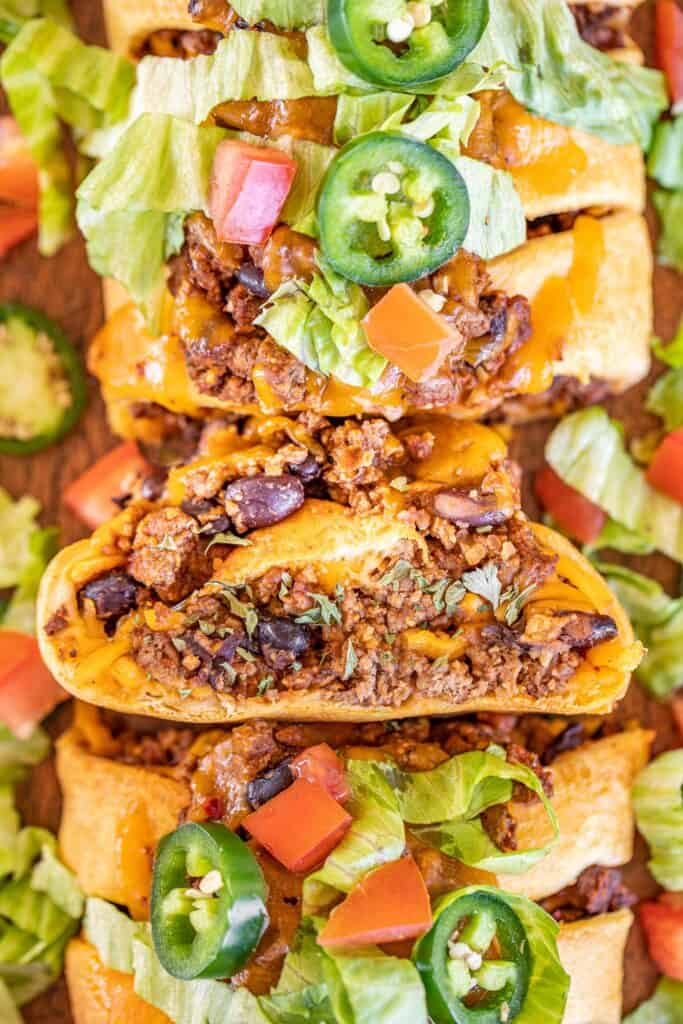 slices of taco crescent braid with lettuce and tomatoes