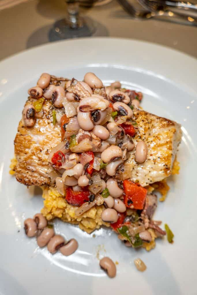 fish topped with black eyed peas