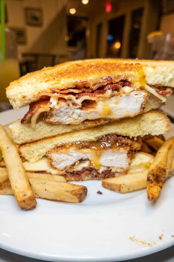 chicken sandwich on toast with fries