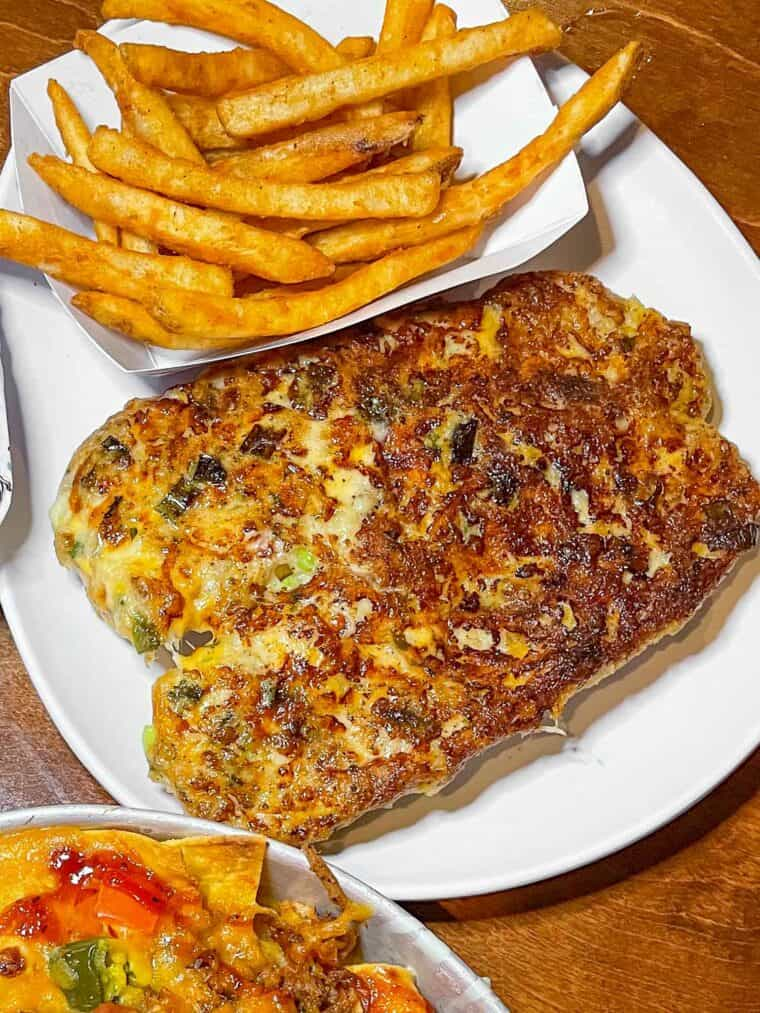 crab melt and fries on a plate
