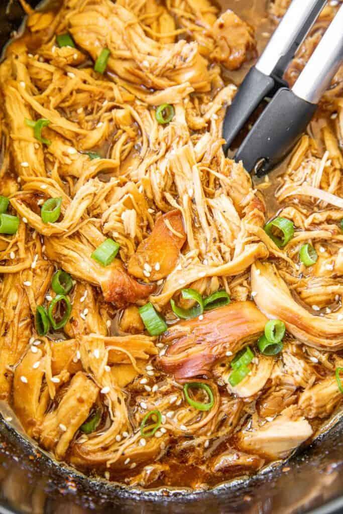 slow cooker of shredded teriyaki chicken