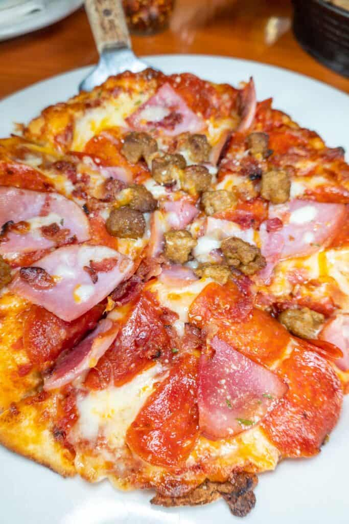 pizza topped with sausage and pepperoni