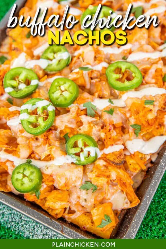baking sheet of doritos buffalo chicken nachos topped with jalapenos