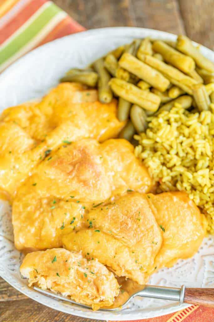plate of chicken crescents with rice and green beans