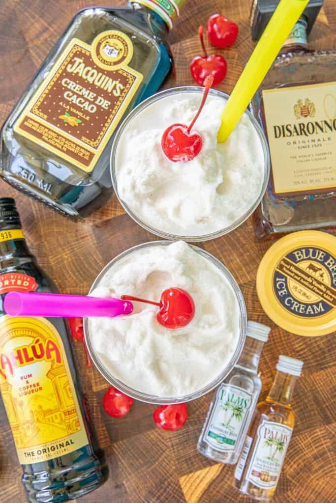 two bushwhacker drinks with liquor bottles