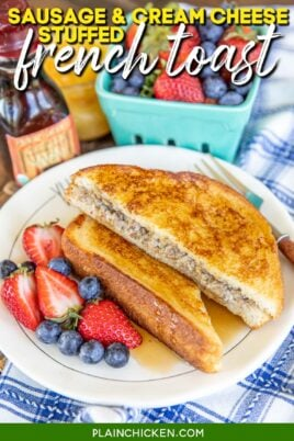 sausage stuffed french toast with fruit on a plate