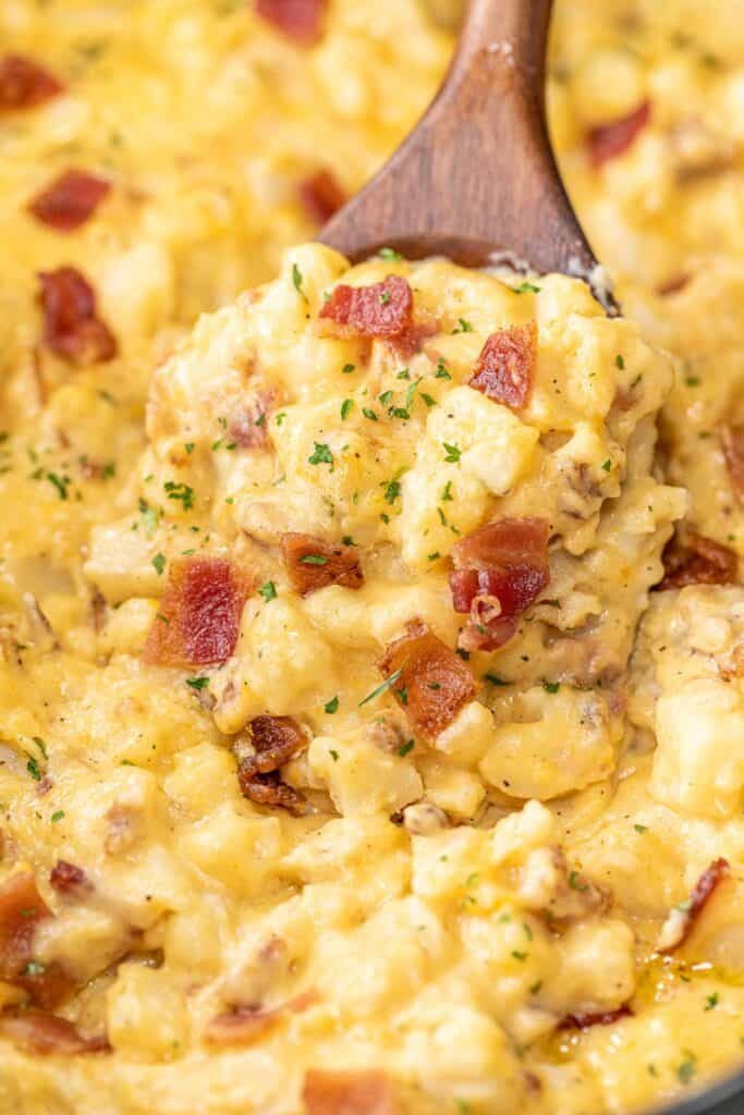 scooping bacon potatoes from slow cooker