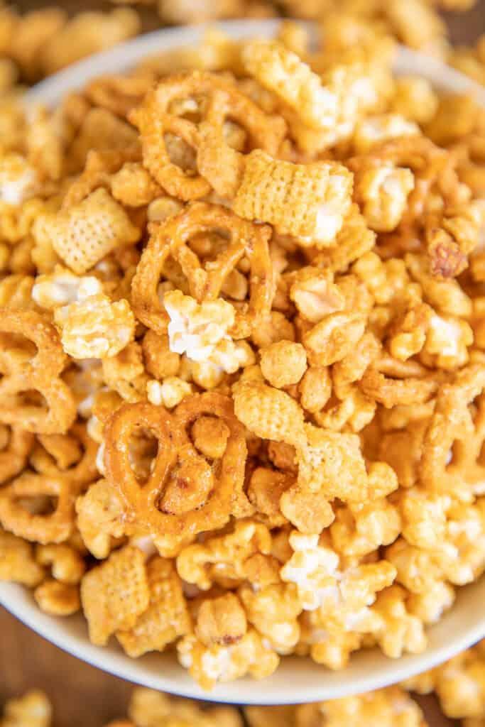 bowl of of caramel pretzels popcorn and peanuts