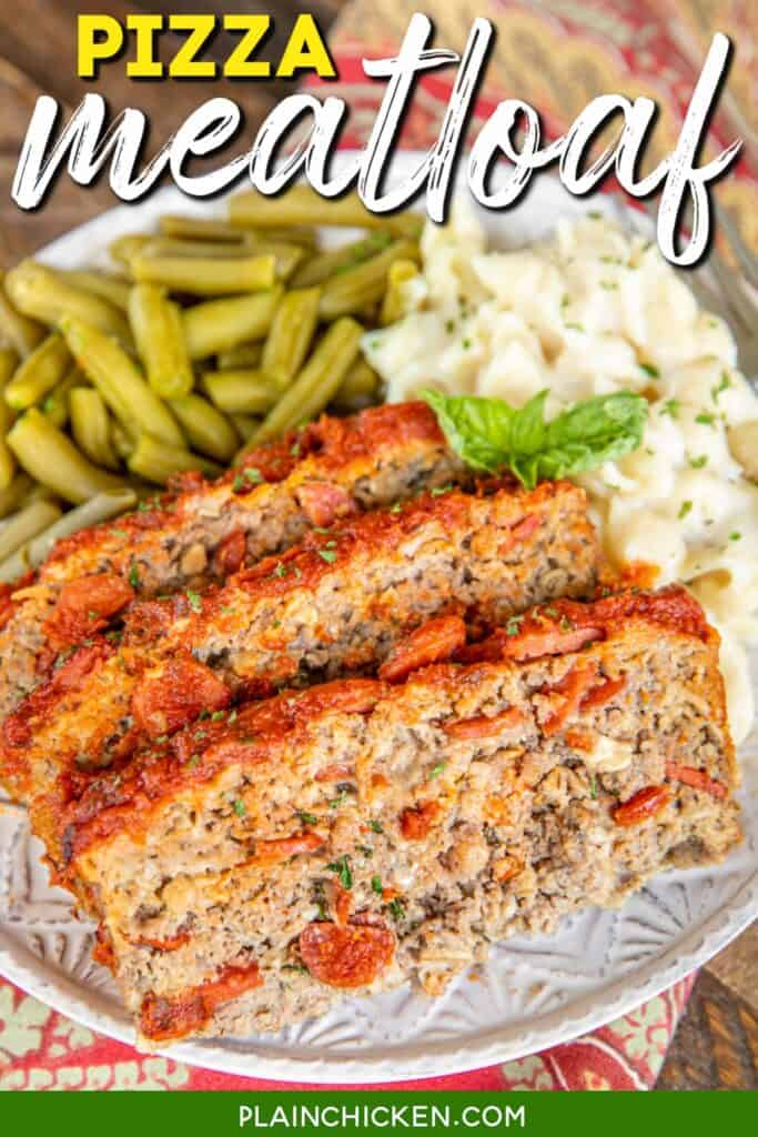 plate of meatloaf with pasta and green beans
