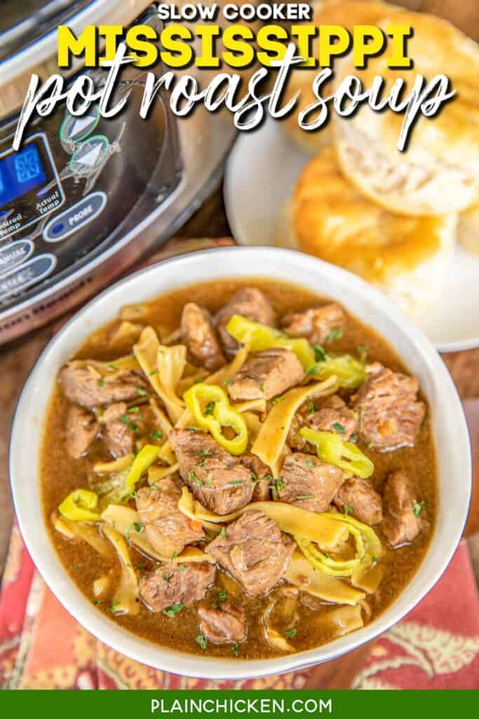 bowl of pot roast soup with a slow cooker behind it
